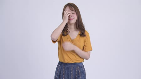 desperate : Young stressed Asian woman getting bad news