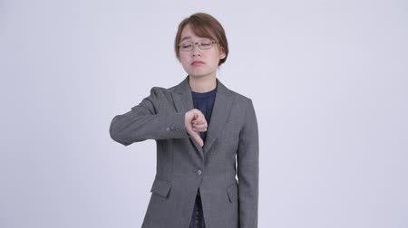 refusing : Young sad Asian businesswoman giving thumbs down