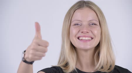 kciuk w górę : Face of young happy blonde woman giving thumbs up Wideo