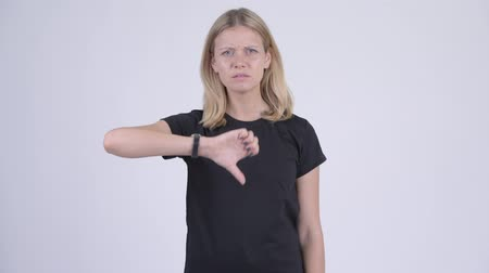 errado : Young angry blonde woman giving thumbs down Stock Footage