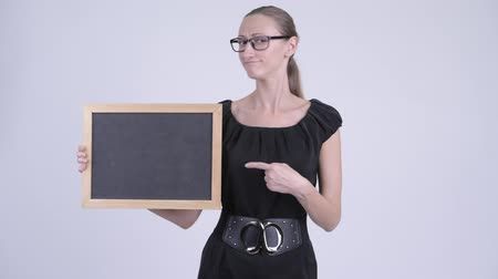 refusing : Sad blonde businesswoman holding blackboard and giving thumbs down