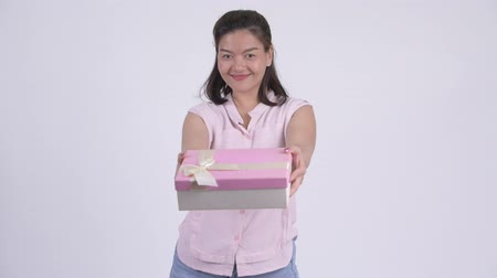 box : Young happy Asian businesswoman giving gift box