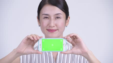 vlogging : Face of happy beautiful Asian businesswoman showing phone Stock Footage