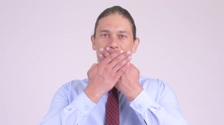 sayings : Handsome businessman covering mouth as three wise monkeys concept Stock Footage