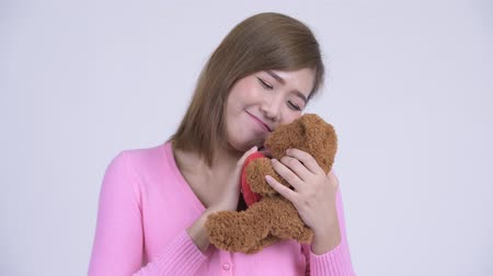 infantil : Face of young Asian woman with teddy bear acting childlike