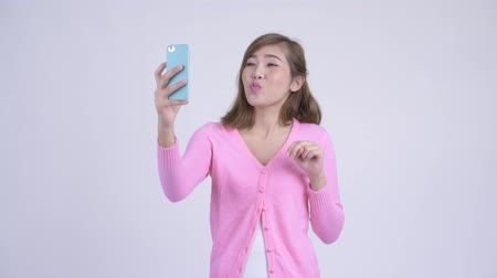 vlogging : Young happy Asian woman taking selfie