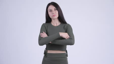 arme verschränkt : Young beautiful woman with arms crossed