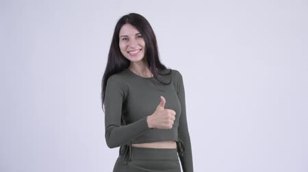 承認する : Happy young beautiful woman giving thumbs up 動画素材