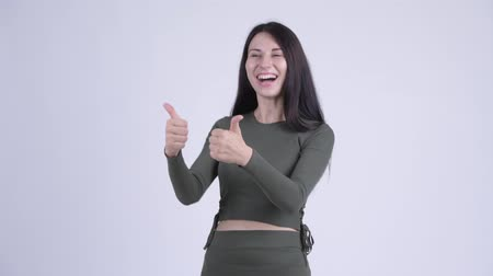 pensamiento positivo : Happy young beautiful woman looking excited while giving thumbs up