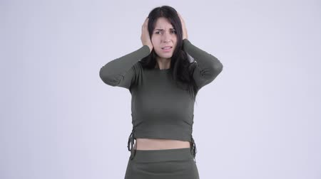 шум : Young stressed woman covering ears from loud noise Стоковые видеозаписи