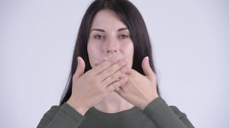 moudrý : Face of young beautiful woman covering mouth as three wise monkeys concept Dostupné videozáznamy