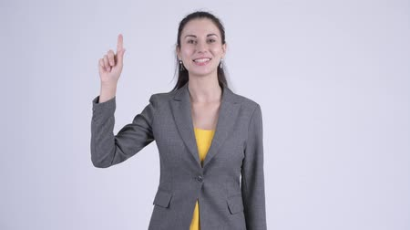 egyenes haj : Happy young beautiful businesswoman pointing up