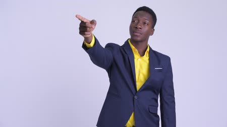 guinean : Young happy African businessman directing and pointing finger