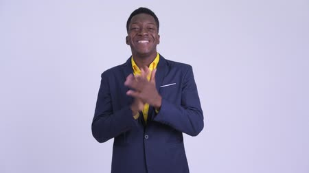 ovation : Young happy African businessman clapping hands