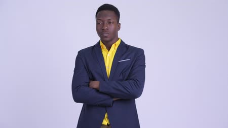 guinean : Young angry African businessman with arms crossed