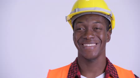 guinean : Face of young happy African man construction worker thinking
