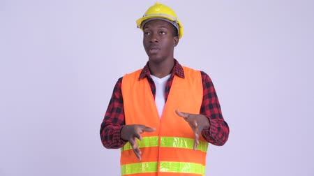 guinean : Young African man construction worker explaining something