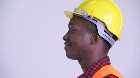 guinean : Closeup profile view of happy young African man construction worker smiling