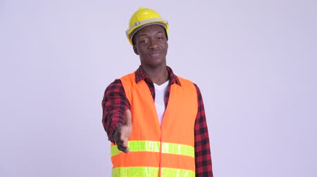 guinean : Young happy African man construction worker giving handshake
