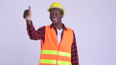 guinean : Young happy African man construction worker giving thumbs up