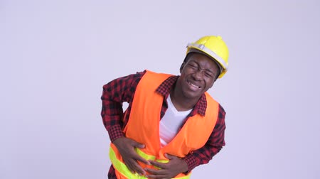 stipsi : Young stressed African man construction worker having stomach ache