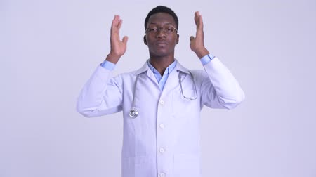moudrý : Young African man doctor showing hear no evil concept