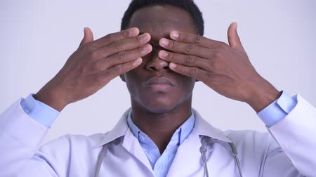 moudrý : Face of young African man doctor showing see no evil concept