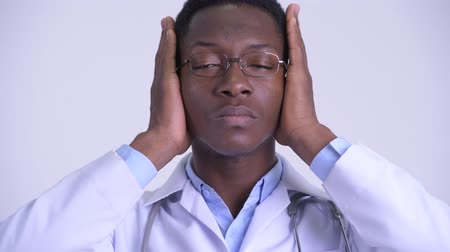 moudrý : Face of young African man doctor showing hear no evil concept