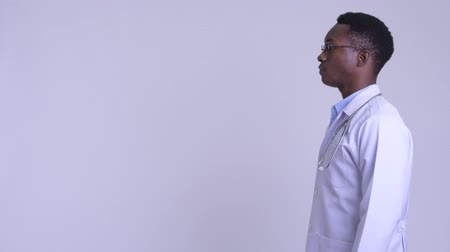 guinean : Profile view of young handsome African man doctor
