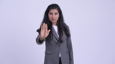 paquistão : Young serious Persian businesswoman showing stop gesture Stock Footage