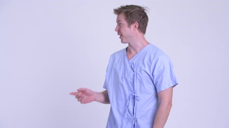 refusing : Profile view of young man patient refusing and showing stop gesture Stock Footage