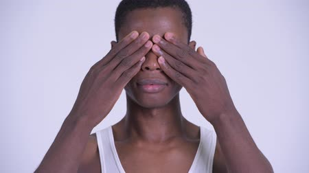 sayings : Face of young handsome African man showing see no evil concept