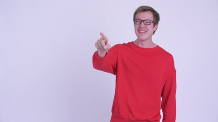 přímý : Happy young handsome man pointing finger Dostupné videozáznamy