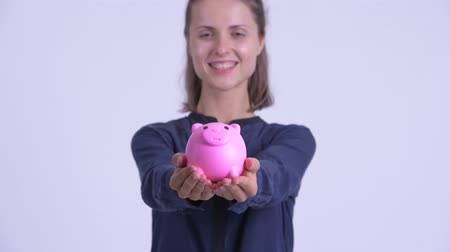 piggy bank : Happy young beautiful businesswoman giving piggy bank Stock Footage