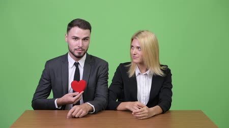 together trust : Young businessman flirting with young businesswoman while working
