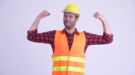 perzisch : Happy bearded Persian man construction worker flexing both arms Stockvideo