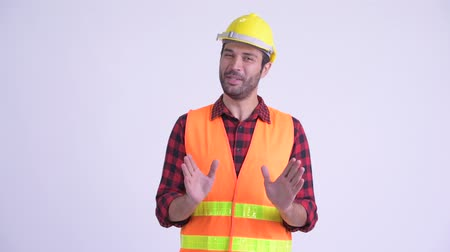 perzisch : Happy bearded Persian man construction worker explaining something