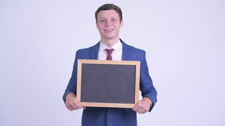 tablica : Happy young handsome businessman holding blackboard