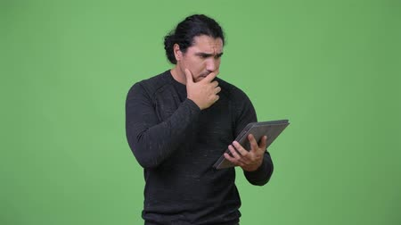 tied : Handsome man using digital tablet and looking shocked Stock Footage