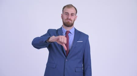 disappointment : Stressed bearded businessman giving thumbs down