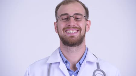 medics : Face of happy bearded man doctor talking to camera
