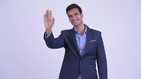 positief denken : Young happy Indian businessman in suit waving hand