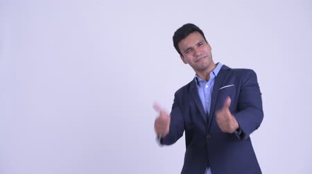 human like : Happy young Indian businessman showing something and giving thumbs up