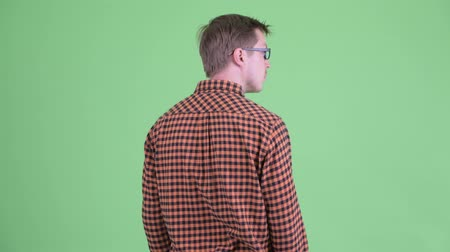 looking far away : Rear view of young hipster man waiting and thinking