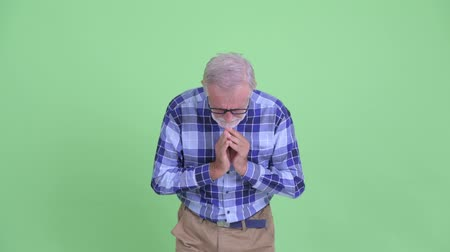 pleading : Senior bearded hipster man praying