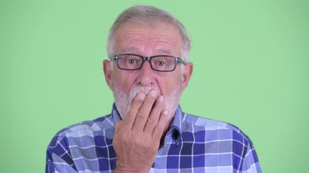 felnőtt : Face of senior bearded hipster man looking shocked and covering mouth
