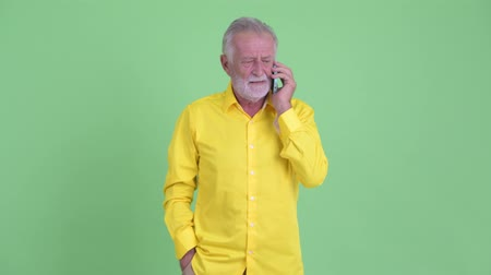 phone call screen : Happy senior bearded businessman talking on the phone