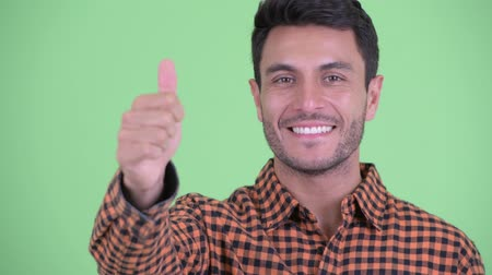 spanish style : Face of happy young Hispanic hipster man giving thumbs up