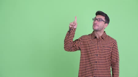 nerd : Happy young Hispanic hipster man pointing up and giving thumbs up Vídeos