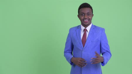 mustache : Happy young African businessman snapping fingers and talking Stock Footage
